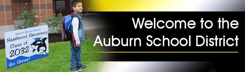 Welcome to Auburn School District Header - Kindergarten student on 1st day of school.